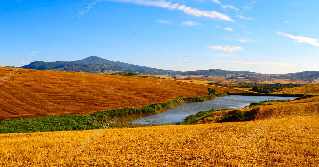 Tuscany Landscape With Pond In The Morning  Stock Photo #3662760