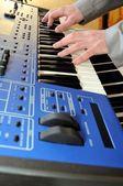 Man playing synthesizer — Stock Photo