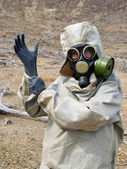 Gas mask, gloves, the person — Stock Photo