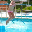 Jumping in pool - Stock Photo