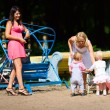 Mothers playing with children — Stock Photo