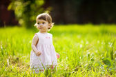 Little girl in flowers — Stock Photo