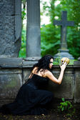 Witch with scull — Stock Photo