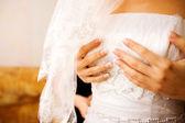 Bride dressing up — Stock Photo