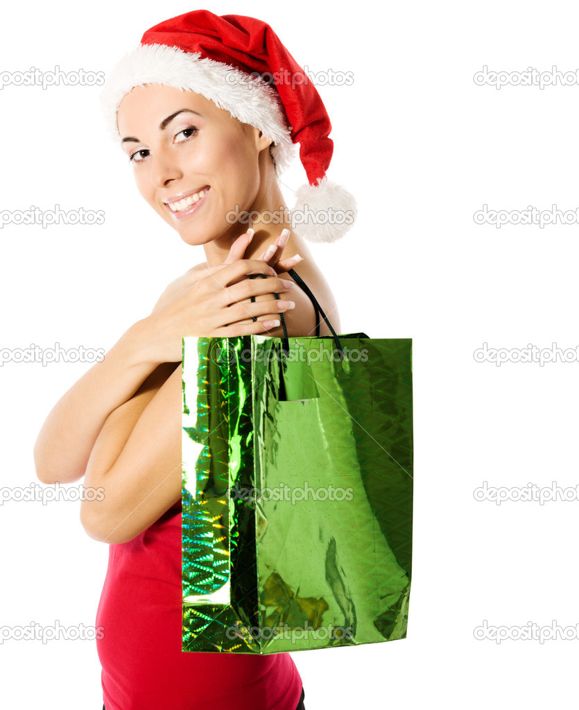 Santa girl holding golden gifts and smiling isolated — Stock Photo #3801704