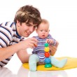 Stock Photo: Baby playing with father