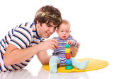 Baby playing with father — Stock Photo
