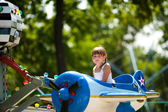 Girl riding carousel — Stock Photo