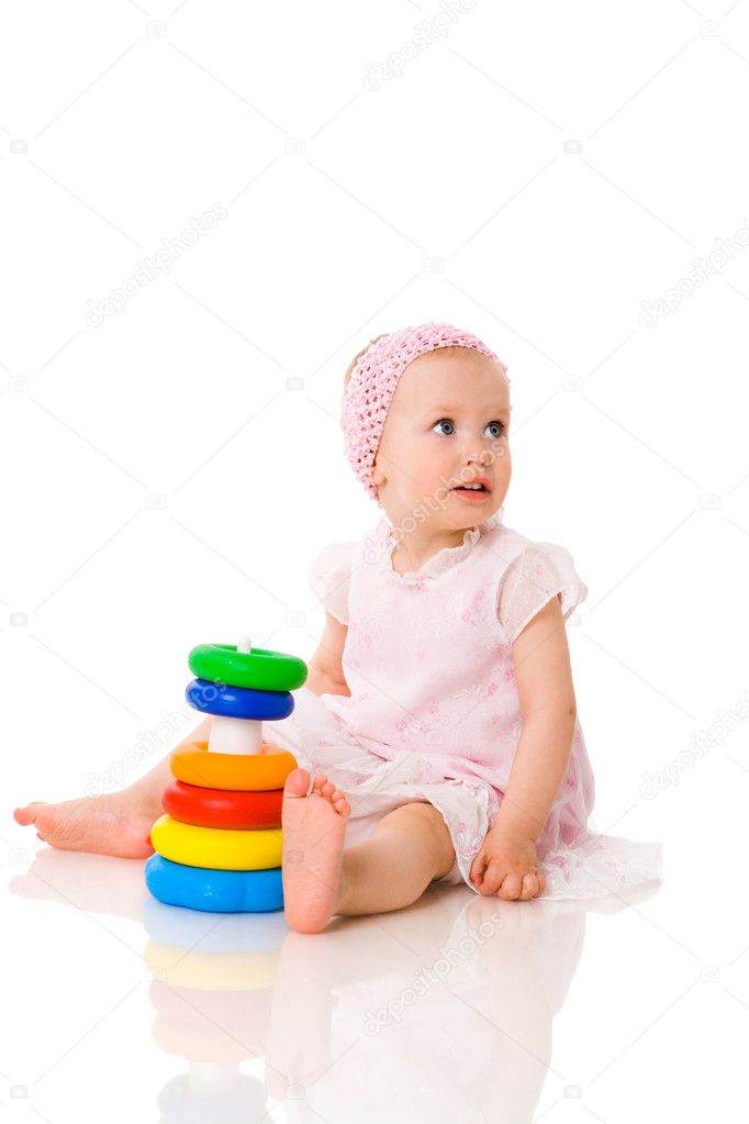 Baby playing with pyramid isolated on white — Stock Photo #3885278