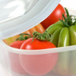 Tomatoes In A Plastic Box - Stock Photo