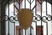 Coat of arms on grating — Stock Photo