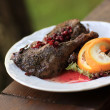 Roast duck with pomegranate gravy - Stock Photo
