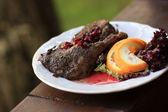 Roast duck with pomegranate gravy — Stock Photo