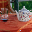 Carafe with juice and teapot - Stock Photo