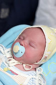 Sleeping baby with pacifier — Stock Photo