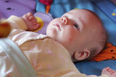 Baby in bed before sleep — Stock Photo