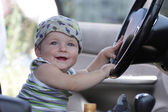 Baby poses in car — Stock Photo