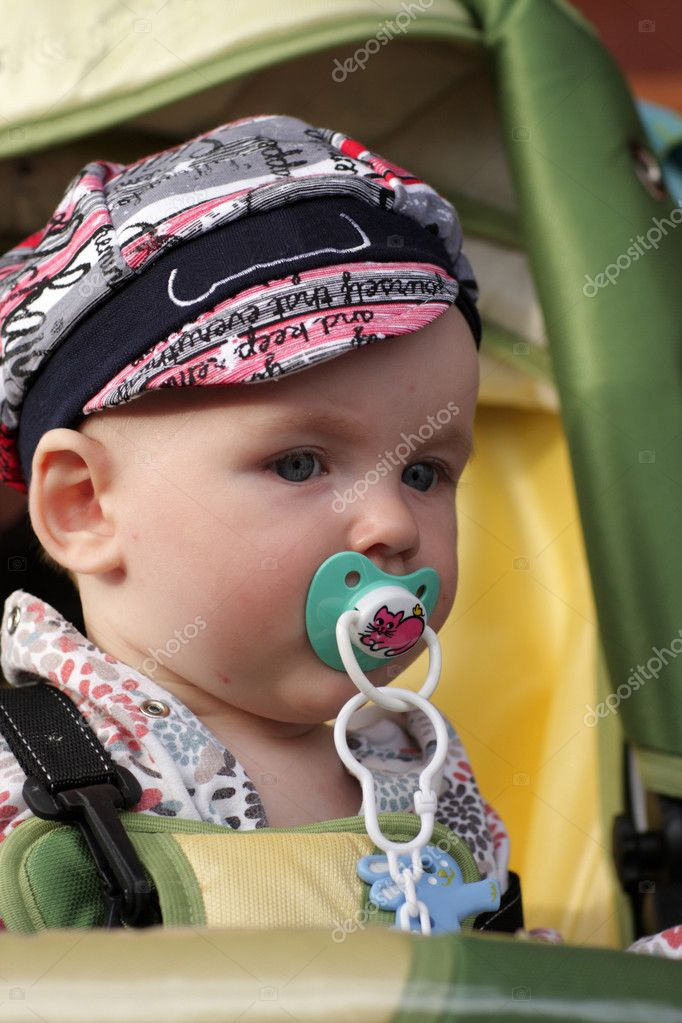 Portrait of serious baby in perambulator outdoor — Stock Photo #3572690