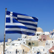 Greece flag on Oia background — Stok fotoğraf