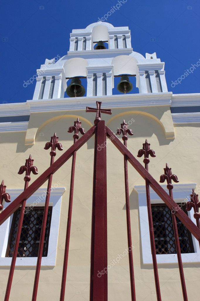 Belfry of church behind grating at Santorini island, Fira — Stock Photo #3810856