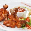 Chicken wings with spicy barbecue sauce - Stock Photo