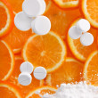 White pills with oranges - Stock fotografie