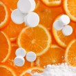 White pills with oranges - Foto Stock