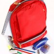 A red school backpack with school supplies — Stock Photo