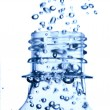 Bottle in pure water with bubbles - Foto Stock
