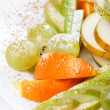 Fresh fruits on the plate — Stock Photo
