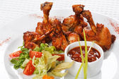 Chicken wings with hot spicy barbecue sauce — Stock Photo