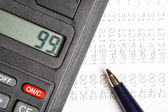 Calculator and pen — Stock Photo