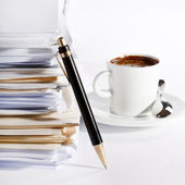 Coffee and stack of paper — Stock Photo