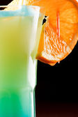 Summer drink decorated with a slice of orange — Stock Photo