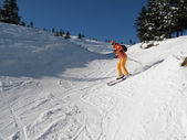 Girl skier in motion — Stock Photo
