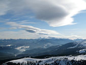 Beautiful sky above snow mountains — Stock Photo