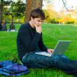 In park with laptop — Stock Photo