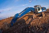 Blue excavator — Stock Photo