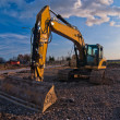 Yellow excavator and blue sky — Stock Photo