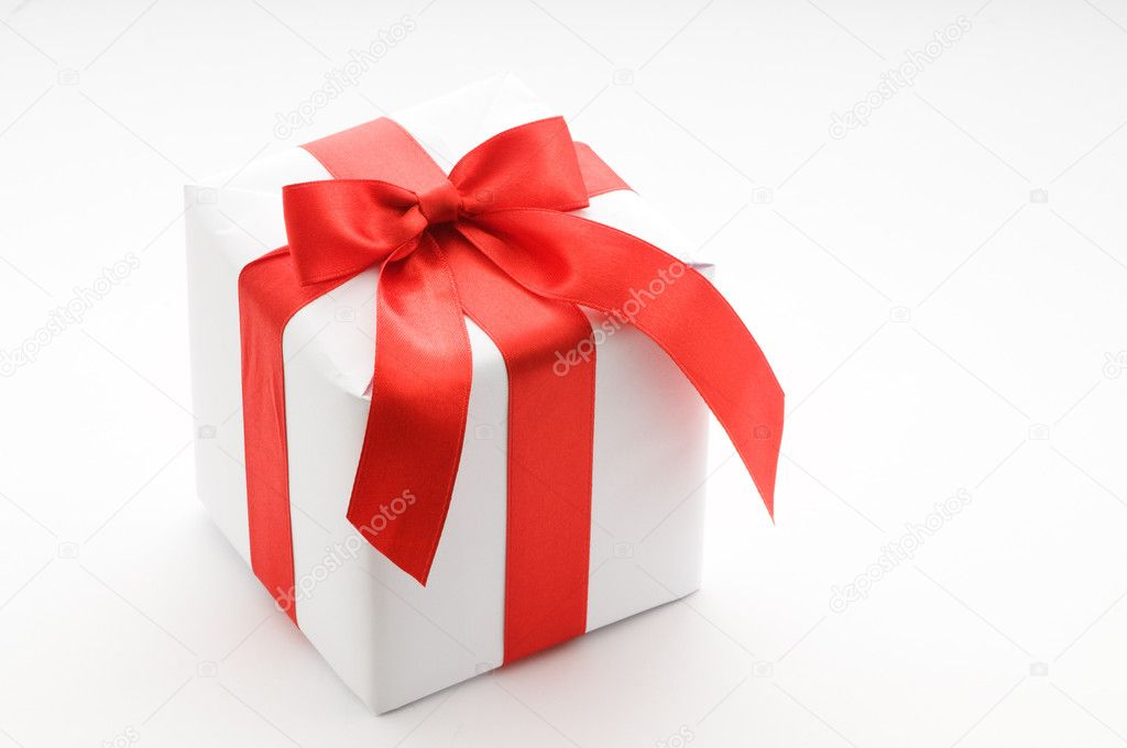 White gift box with red ribbon — Stock Photo #2770994