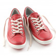 Red leather sneakers — Stock Photo