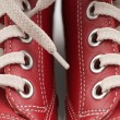 Red leather sneakers - Stock Photo