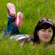 Stock Photo: Beautiful woman lying on grass