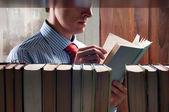 Men reading a book — Stock Photo