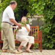 Couple seniors in house garden — Stock Photo