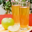Apple juice glasses — Stock Photo