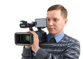 Young man with digital video camera — Stok fotoğraf
