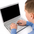 Young man working of a laptop — Stock Photo
