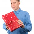 Young man with a gift box — Stock Photo #2789420