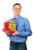Young man with gift boxes — Stock Photo